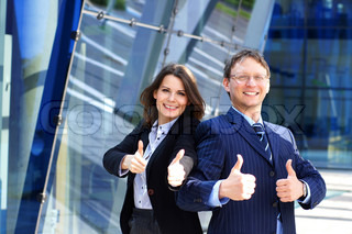 Conceptual photo of businessman and his female assistant