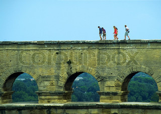 People walking on arch bridge