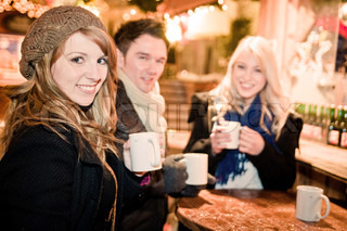 Young People drinking Punch at Christmas Market