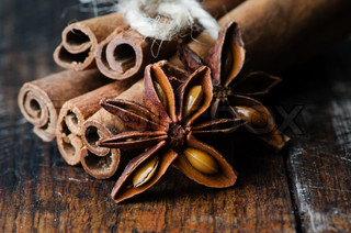 Star anise with cinnamon at christmas time on wooden table close up