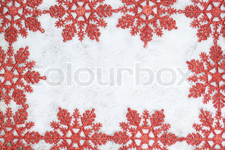 Christmas decorative frame with snowflakes on snow