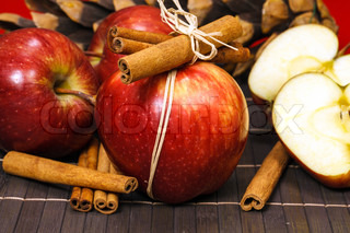Red apples  with cinnamon sticks