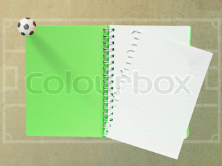 Blank Note Book with plasticine football on paper background green