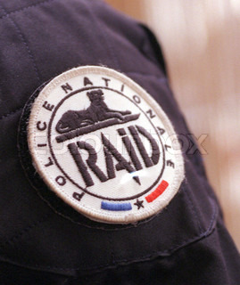 Close-up of a symbol on police uniform