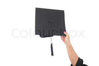 hand throwing graduation hats in the air