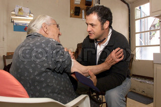 Doctor examining an aged patient