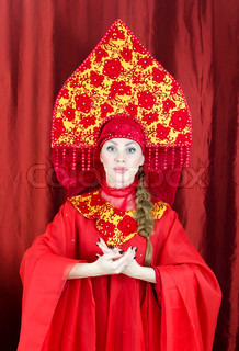 Woman in russian traditional clothes welcomes you
