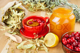 cranberries, jar with honey, fruit tea cup, healing herbs and lemon