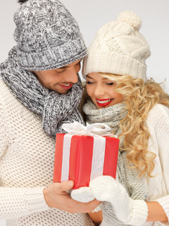 romantic couple in a sweaters with gift box