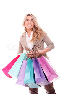Beautiful mid aged woman holding shopping bags