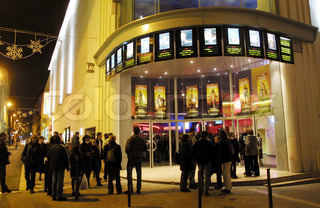 People standing outside multiplex