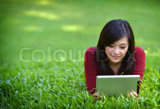 pretty woman using tablet
