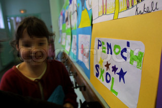 View of a girl standing beside chart paper