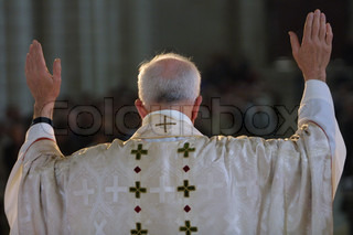 Rear view of Catholic priest in the in the church