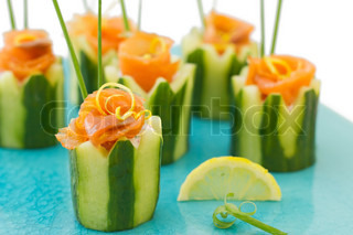 Salmon appetizer serve in cucumber shaped base