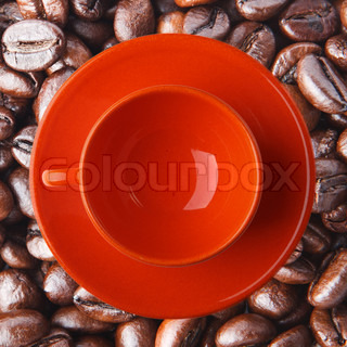 Orange cup on the coffee beans Close up