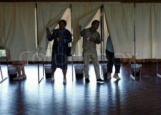 People voting in voting booth for president elections