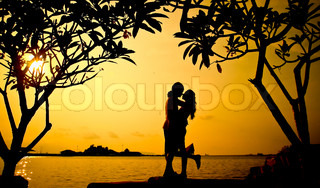 A warm loving hug on sunset