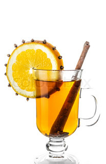 A warm drink with orange, cinnamon, isolated