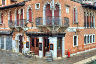 Corner view on traditional red brick venetian house on small plaza in Venice, Italy