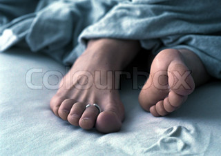 Image of 'feet, bed, toe'