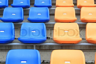 plastic, yellow and blue, new chairs in stadium
