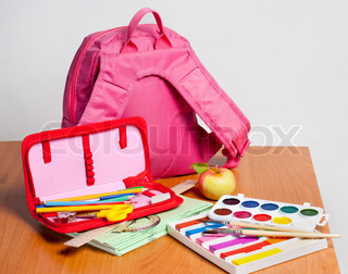 Portfolio and school supplies on the table