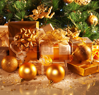 Christmas presents wrapped in gold