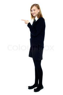 Student standing sideways and pointing forward