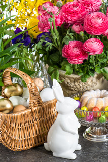 spring flowers with easter eggs and bunny