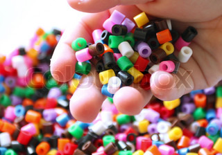 Children playing with plastic beads