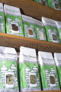 Close-up of herbal packets displayed on shelf