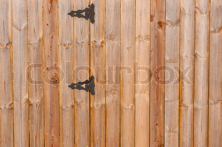 Wooden background with metal lock
