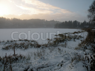 mist coming up over the ice of the lake