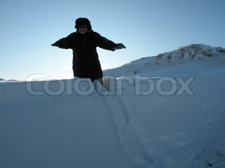 woman about to fall down into deep snow