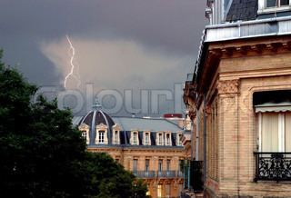 Built structure against cloudy sky and lightning
