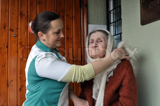 Nurse helping an old woman