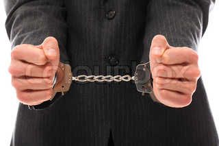 Close up of businessman hands in handcuffs