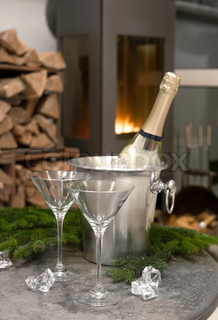 romantic table setting with champagne and fireplace