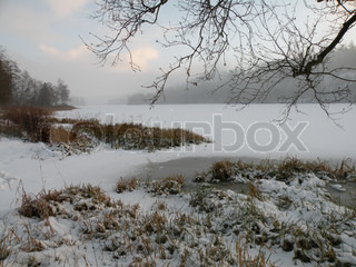view on frozen lake with snow