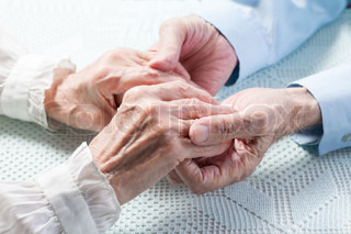 Old people holding hands Closeup