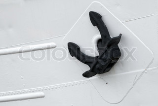 Black ships mooring anchor on white hull