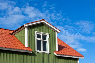 Residential Roof Top under the Bright Blue Sky