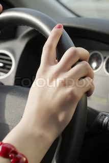 Girl hand on wheel steering