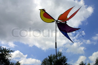 Close-up of weather vane against cloudy sky