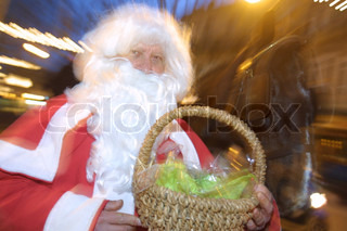 Portrait of Santa Claus carrying gifts
