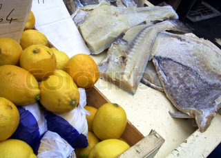 High angle view of lemons and cod