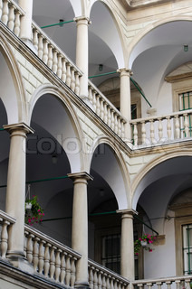Columns with arches and balustrades in italian courtyard Palace Kornyakta in Lvov, Ukraine