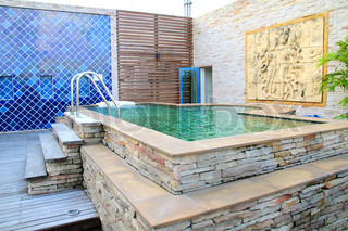 outdoor jacuzzi with thai stone carving wall
