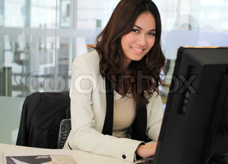 Young asian business woman using a computer